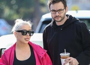 Christina Aguilera makes a rare public appearance in hot pink jacket