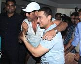 Aamir Khan greeted by Jackie Shroff at his 50th birthday celebration