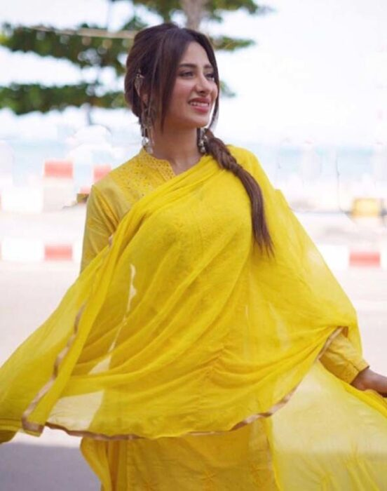 Mahira Sharma wears a bright yellow Punjabi suit, looks amazing with the sweet smile on her face