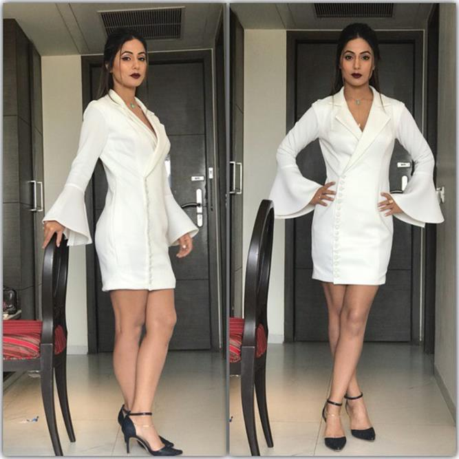 Hina Khan is a vision in white in a white tuxedo dress also wearing black pointed heels and sho totally nailed the dark brown lipstick look.