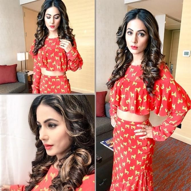 Hina Khan's curls just always melt our hearts. She looks pretty in red dress with red lips.
