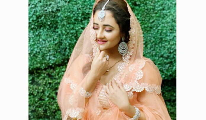Rashami Desai looks gorgeous in a peach lehenga and lovely maang tikka in her latest post from the sets of Naagin