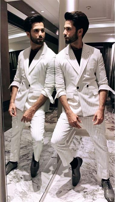 Shahid Kapoor is seen wearing a white striped suit