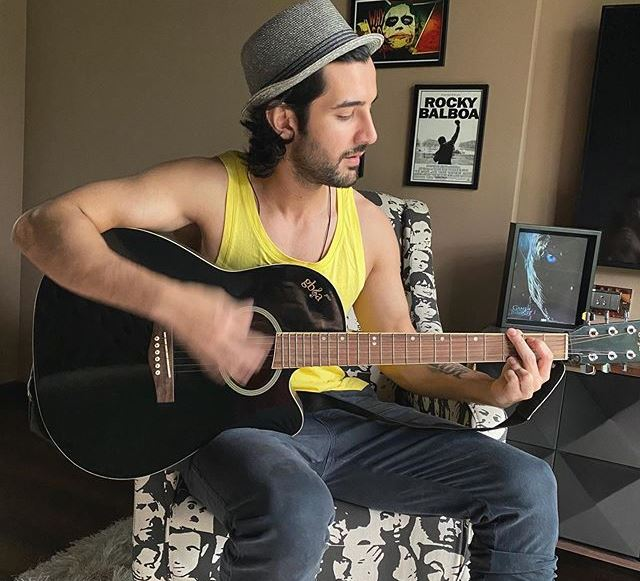 Aditya Seal with a guitar