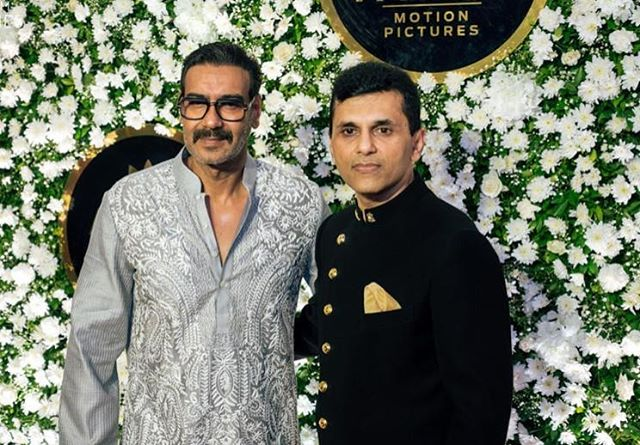 Ajay Devgn with Anand Pandit