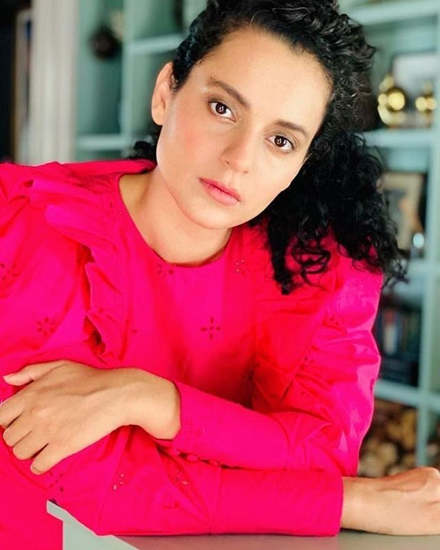 Kangana Ranaut in a bright pink outfit