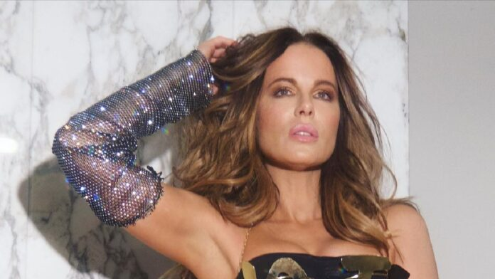 Kate Beckinsale stuns fans in gold 'Vote' bra on Election day