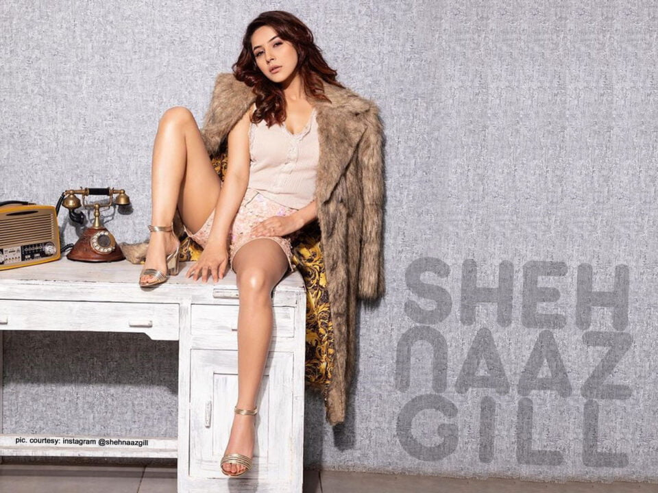 Bigg-Boss-contestant-and-singer-Shehnaaz-Gill-sporting-beige-sequined-hot-pants-blush-pink-top-and-a-long-fur-coat-wallpaper-2