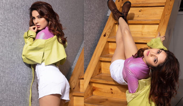 Shehnaaz Gill flaunts her shiny pink crop top and neon jacket in her latest photoshoot