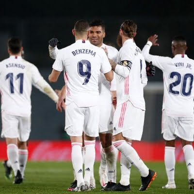 Real Madrid beat Granada to tie league leader Atletico on points
