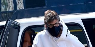 Amitabh Bachchan in a white full sleeve pull over