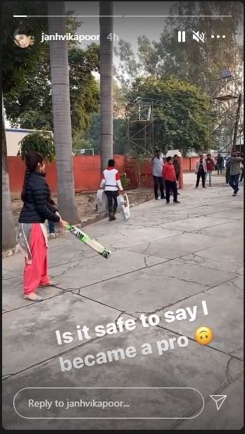 Janhvi Kapoor in cricketing action with the bat