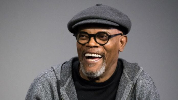 Samuel L Jackson shows off his 'Avengers' face mask as he receives Covid-19 vaccine