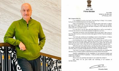 Anupam Kher with a signed letter from PM Narendra Modi