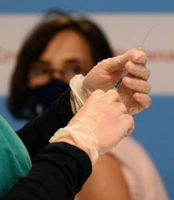Flu shot linked to fewer, less severe Covid cases: study