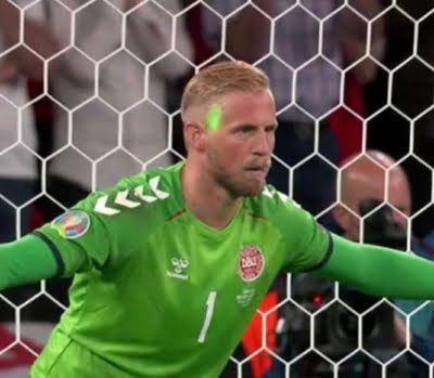 Calls for ban on fan who distracted Danish goalkeeper with laser beam