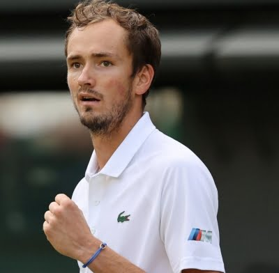 Medvedev rallies to overcome Cilic in five-setter
