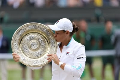 Wimbledon: Ex-cricketer Ashleigh clinches title in three sets