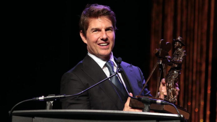 Tom Cruise jumps off a cliff on a motorcycle!