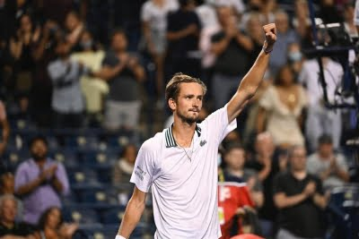 Medvedev beats Isner, sets up title clash with American Opelka