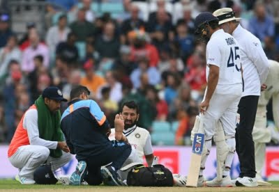Sharma, Pujara suffer niggles, don't come out to field