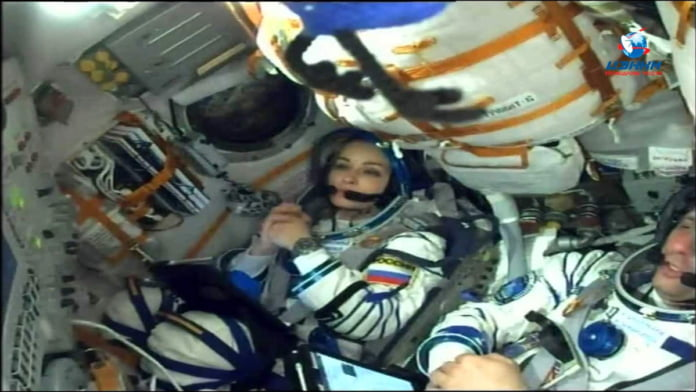 Russian film crew docks on space station to shoot movie